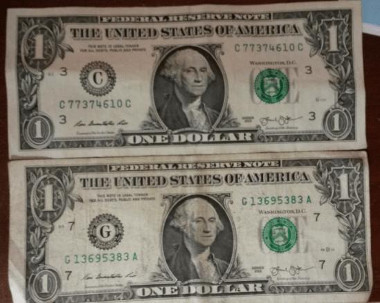 Dollar bill with a slight miscut